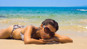 Woman relaxing on a tropical beach Royalty Free Stock Image