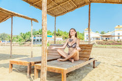 Woman relaxing in tropical resort Stock Photos