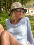 Woman relaxing on tropical shoreline royalty free stock photos