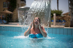 Woman relaxing under fountain Royalty Free Stock Photography