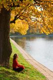 Woman relaxing under a tree Stock Photo