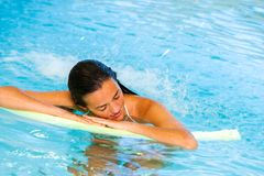 Woman relaxing under water cascade in spa. Stock Photography