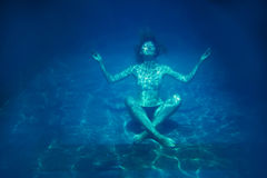 Woman relaxing under water stock photos