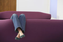 Woman Relaxing Upside Down On Sofa Stock Photos