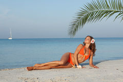 Woman relaxing vacation. Slim woman in bikini on relaxing on beach summer vacation Royalty Free Stock Photography