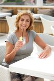 Woman relaxing on vacation with glass of water Royalty Free Stock Photos