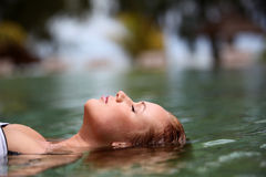 Woman relaxing in water Stock Image