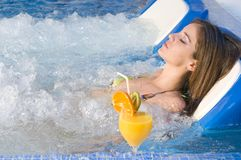 Woman relaxing in a water bed in an spa. Woman relaxing in a water bed spa royalty free stock photos