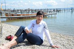 Woman relaxing at the waterfront at lake chiemsee Stock Images