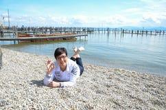 Woman relaxing at the waterfront at lake chiemsee Stock Image