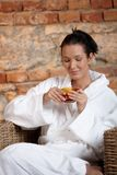 Woman relaxing in wellness Stock Images