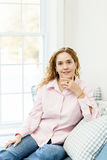 Woman relaxing by the window Royalty Free Stock Photo