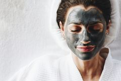 Free Woman Relaxing With A Charcoal Facial Mask Royalty Free Stock Images - 120956729