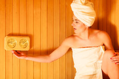 Woman relaxing in wooden sauna room Royalty Free Stock Image