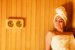 Woman relaxing in wooden sauna room Royalty Free Stock Photo