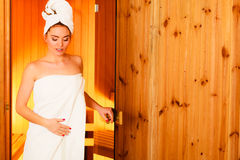 Woman relaxing in wooden sauna room Stock Photography