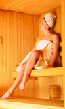 Woman relaxing in wooden sauna room Royalty Free Stock Photos