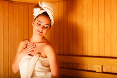 Woman relaxing in wooden sauna room Royalty Free Stock Images