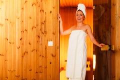 Woman relaxing in wooden sauna room Stock Image