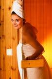 Woman relaxing in wooden sauna room Stock Photo