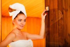 Woman relaxing in wooden sauna room Stock Photos