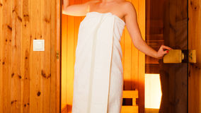 Woman relaxing in wooden sauna room Stock Images