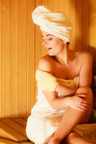 Woman relaxing in wooden sauna room Stock Photos