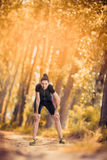 Woman relaxing after work out in the park. Young woman relaxing after work out in the park Stock Images