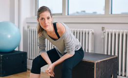 Woman relaxing after workout at gym Royalty Free Stock Photography