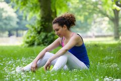 Woman relaxing after workout Royalty Free Stock Images