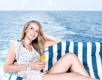 Woman relaxing on the yacht Stock Photos