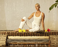 Woman relaxing after yoga Stock Photo