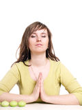 Woman relaxing in yoga position Stock Photo