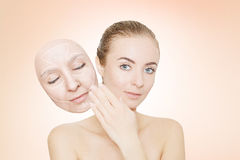Woman releases her face from wrinkles Stock Photo