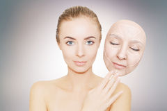Woman releases her face from wrinkles and bad skin Stock Photography