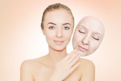 Woman releases her face from wrinkles and bad skin. Woman releases her face from wrinkles Royalty Free Stock Photo