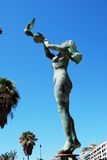 Woman releasing a dove statue, Fuengirola. Royalty Free Stock Images