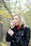 Woman relieving asthmatic attack using inhaler Stock Photography