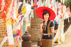 Woman with religion flag at temple. In Songkran festival Royalty Free Stock Images