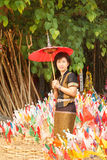 Woman with religion flag at temple. In Songkran festival Stock Photo