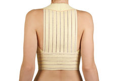 Woman in remedial corset for posture correction royalty free stock photography
