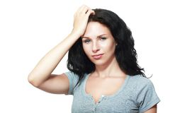 Woman remembered something. Portrait of lovely brunette woman remembered something and holds a hand Stock Photo