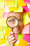 Woman with reminder notes and magnifying glass Royalty Free Stock Images