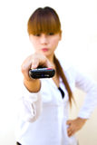 Woman with remote control. Close-up focused on remote control Royalty Free Stock Image