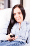 Woman with remote control Royalty Free Stock Photo