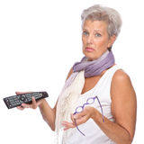 Woman with remote control Royalty Free Stock Photography