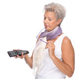 Woman with remote control Royalty Free Stock Photos