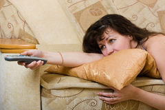 Woman with a remote control. Watching TV Stock Photo