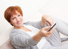 Woman with remote control Stock Photos