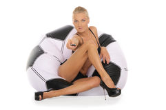 Woman with remote control in chair of soccer ball Stock Photos